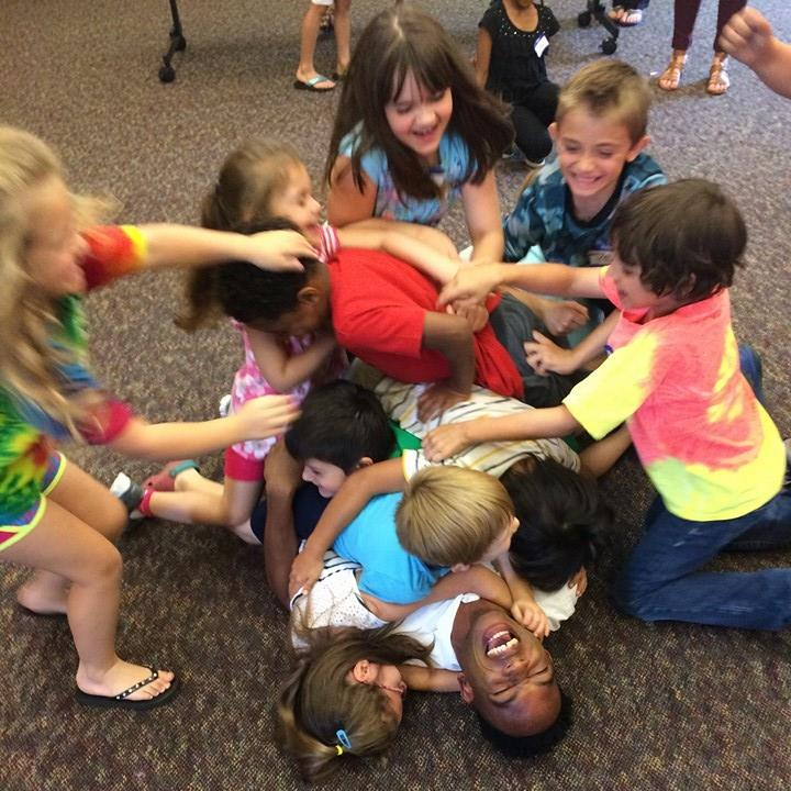 Sami Haggood with young patrons at Iberia Parish Library